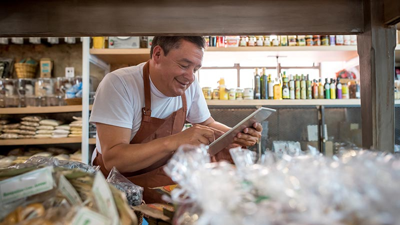 Business owner using a tablet for business